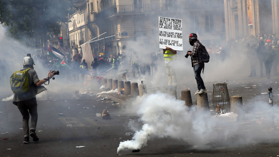 Tear gas canisters lie on the ground during a May Day demonstration in Paris, on May 1, 2019. (Francois Mori / AP)
