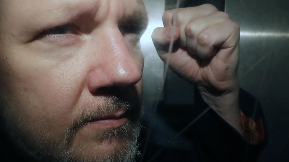 WikiLeaks founder Julian Assange being taken from court in London, on May 1, 2019. (Matt Dunham / AP)
