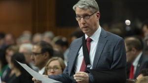 Parliamentary Secretary to the Minister of Foreign Affairs Andrew Leslie rises during Question Period in the House of Commons Thursday April 11, 2019 in Ottawa. A first-time Liberal MP and long-time military man says he won't run for re-election this fall. THE CANADIAN PRESS/Adrian Wyld