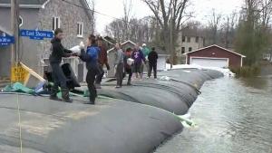 Neighbours in Ottawa's Cumberland community purchased the aqua dam for $70,000.