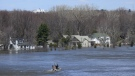 Homes along the Ottawa River in Gatineau, Quebec are flooded on Tuesday, April 30, 2019. THE CANADIAN PRESS/Sean Kilpatrick