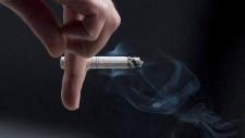 A person smokes a cigarette