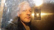 Julian Assange is taken from court in London