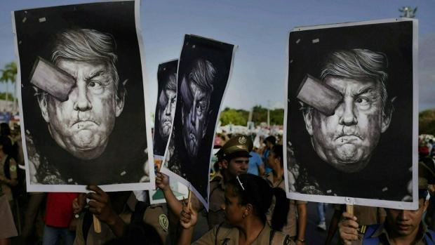 Cuban soldiers carry depictions of Trump in Havana