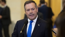 Alberta Premier Jason Kenney speaks to reporters after appearing at the Standing Senate Committee on Energy, the Environment and Natural Resources about Bill C-69 at the Senate of Canada Building on Parliament Hill in Ottawa on Thursday, May 2, 2019. THE CANADIAN PRESS/Justin Tang