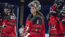 Canada goaltender Shannon Szabados, centre