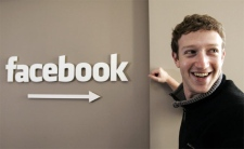 Facebook.com founder Mark Zuckerberg smiles at Facebook headquarters in Palo Alto, Calif., in this Feb. 5, 2007 file photo. (AP / Paul Sakuma)