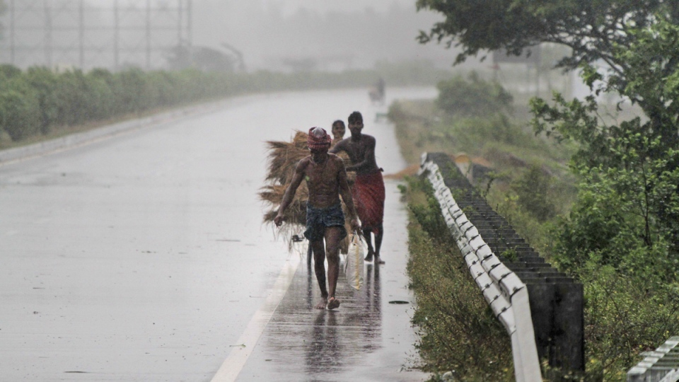 Villagers move to safer places amidst gusty winds ahead of the landfall of Cyclone Fani on the outskirts of Puri, in the Indian state of Odisha, on May 3, 2019.  (AP)