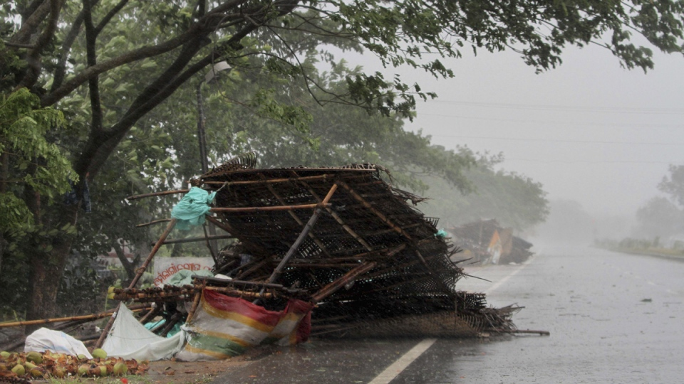 Street shops are seen collapsed due to gusty winds ahead of the landfall of Cyclone Fani in Puri, in the Indian state of Odisha, May 3, 2019. (AP)