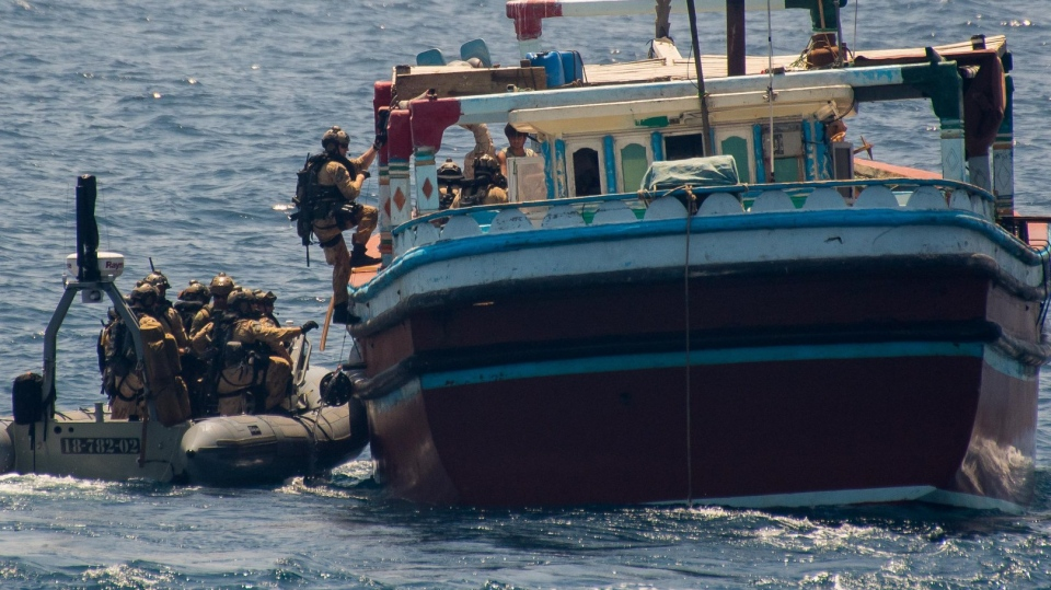 Members of the Naval Tactical Operations Unit, deployed with the Regina, board a suspected drug vessel on May 3, 2019. (Department of National Defence)