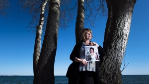 Donna May holds a photograph of her late daughter Jac in Toronto on Thursday, April 14, 2016. THE CANADIAN PRESS/Nathan Denette