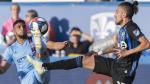 Montreal Impact's Maximiliano Urruti, right, challenges New York City FC's Ismael Tajouri-Shradi during second half MLS soccer action in Montreal, Saturday, May 4, 2019. THE CANADIAN PRESS/Graham Hughes
