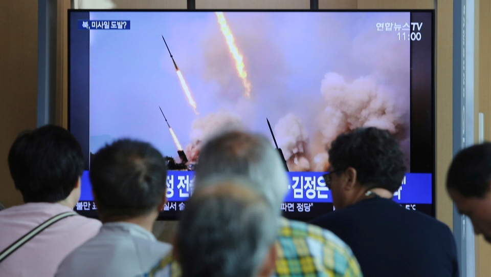 People watch a TV showing a news program reporting North Korea's missile launch, at the Seoul Railway Station in Seoul, South Korea, Sunday, May 5, 2019. (AP Photo/Ahn Young-joon)