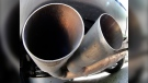 The exhaust pipes of a VW Diesel car are photographed in Frankfurt, Germany, Wednesday, Aug. 2, 2017. (AP Photo/Michael Probst)