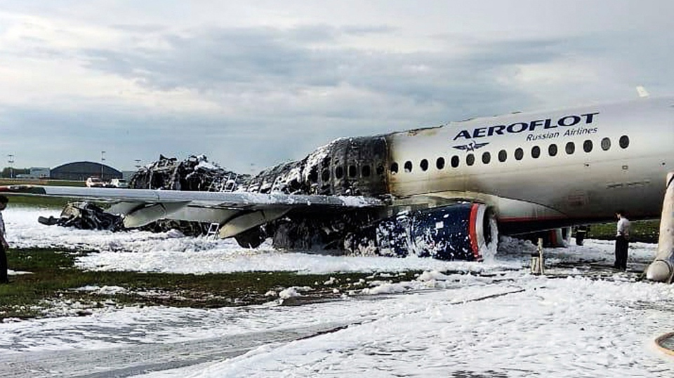 The Sukhoi Superjet 100 aircraft of Aeroflot Airlines is covered in fire retardant foam after an emergency landing in Sheremetyevo airport in Moscow, Russia, Sunday, May 5, 2019. (Moscow News Agency photo via AP)