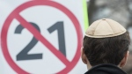A man wears a yarmulke during a demonstration opposing the Quebec government's newly tabled Bill 21 in Montreal, Sunday, April 14, 2019. THE CANADIAN PRESS/Graham Hughes