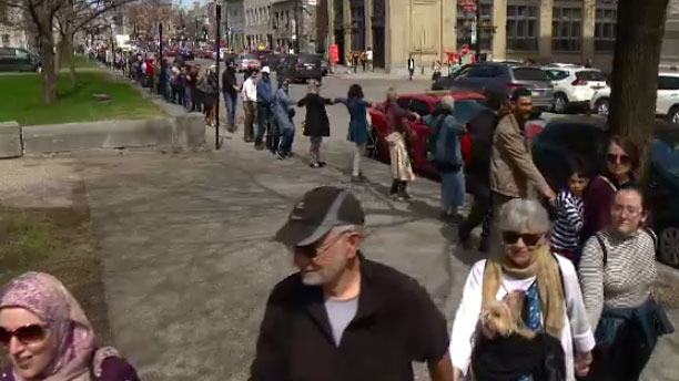 Hundreds of Montrealers formed a human chain around the Palais de Justice on Sun., May 5, 2019 to protest Bill 21.