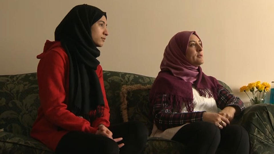 Reema Qaddour (R) and her family met the Gutierrezes through an immigrant support society and is now doing whatever they can to help them out.