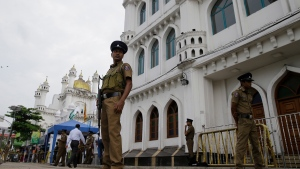 Sri Lankan police officers stand guard outside a Sufi Islamic mosque during Friday prayers in Colombo, Sri Lanka, Friday, May 3, 2019. (AP Photo/Eranga Jayawardena)