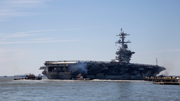 U S  sending aircraft carrier to Mideast, citing Iran
