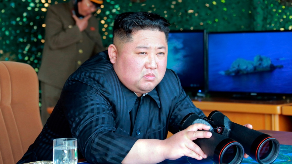 FILE - This Saturday, May 4, 2019, file photo provided by the North Korean government shows North Korean leader Kim Jong Un, equipped with binoculars, observing tests of different weapons systems, in North Korea. (Korean Central News Agency/Korea News Service via AP, File)