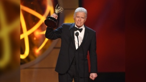"""Alex Trebek accepts the award for outstanding game show host for """"Jeopardy!"""" at the 46th annual Daytime Emmy Awards at the Pasadena Civic Center on Sunday, May 5, 2019, in Pasadena, Calif. (Photo by Chris Pizzello/Invision/AP)"""