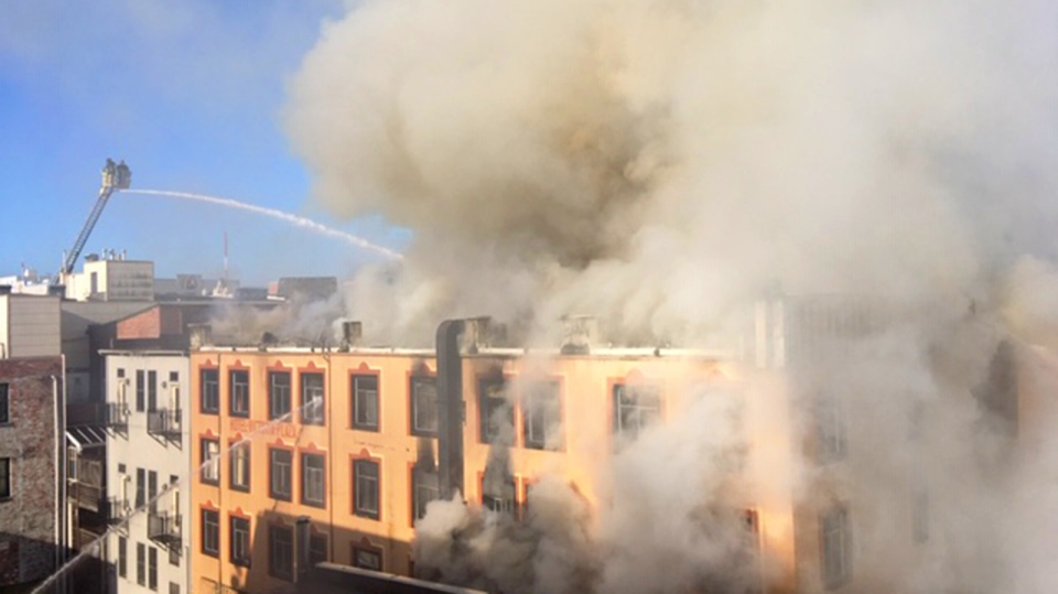 Smoke pours out of windows at the Plaza Hotel in downtown Victoria. May 6, 2019. (CTV Vancouver Island)
