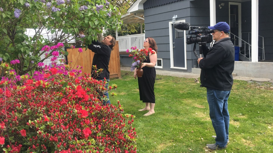 Cervical cancer survivor Jessica Peters gathers flowers with her husband at her home in Chilliwack, B.C. CTV News Vancouver photographer Steve Saunders is also pictured.