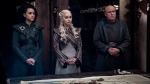 """This image released by HBO shows from left, Nathalie Emmanuel, Emilia Clarke and Conleth Hill in a scene from """"Game of Thrones,"""" that aired Sunday, May 5, 2019. (Helen Sloan/HBO via AP)"""