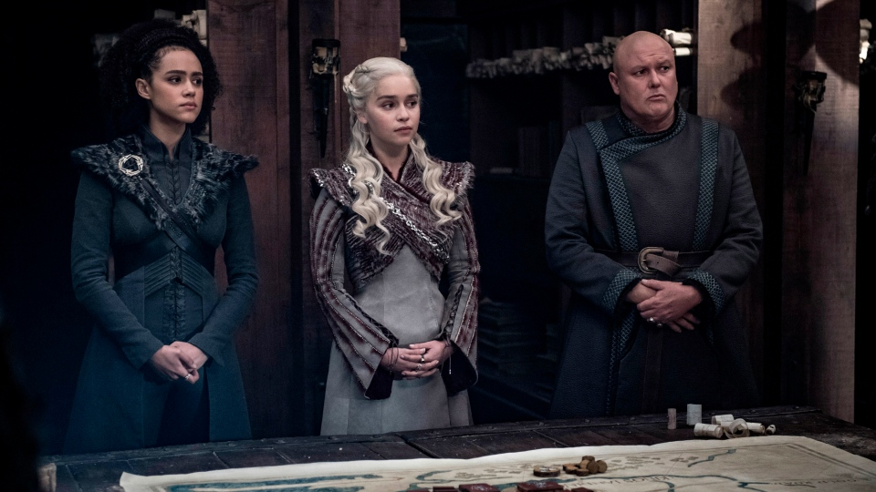 "This image released by HBO shows from left, Nathalie Emmanuel, Emilia Clarke and Conleth Hill in a scene from ""Game of Thrones,"" that aired Sunday, May 5, 2019. (Helen Sloan/HBO via AP)"