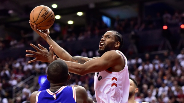 1fcfc2b22 Toronto Raptors forward Kawhi Leonard goes to the net as Philadelphia 76ers  forward James Ennis III defends during second half