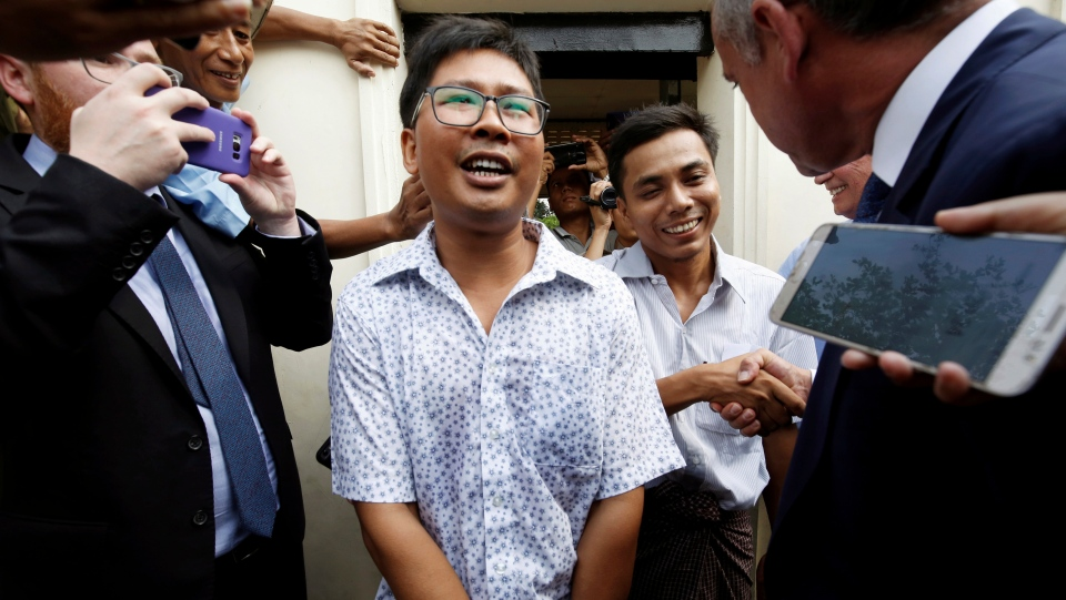 Reuters reporters Wa Lone, front centre, and Kyaw Soe Oo, rear centre, react as they are freed from Insein Prison in Yangon, Myanmar, Tuesday, May 7, 2019. (Ann Wang/Pool Photo via AP)