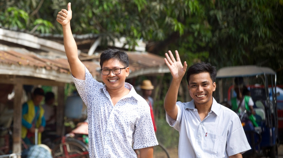 Reuters journalists Wa Lone, left, and Kyaw She Oo wave as they walk out from Insein Prison after being released in Yangon, Myanmar Tuesday, May 7, 2019. (AP Photo/Thein Zaw)