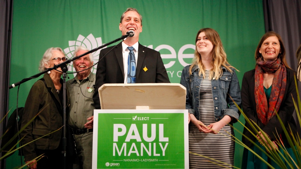 Green Party's Paul Manly celebrates with his family from (left to right), his mother Eva and father Jim, daughter Aven and wife Samantha after results come in for the Nanaimo-Ladysmith byelection at the Cavallotti Lodge in Nanaimo, B.C., on Monday, May 6, 2019. THE CANADIAN PRESS/Chad Hipolito