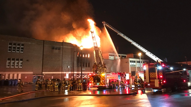 Crews battle a five-alarm fire at York Memorial Collegiate Institute Tuesday May 7, 2019. (Mike Nguyen /CP24)