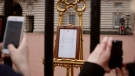 People take pictures of the notice on an easel in the forecourt of Buckingham Palace, London, Tuesday, May 7, 2019, placed on Monday to formally announce the birth of a baby boy to Britain's Prince Harry and Meghan, Duchess of Sussex. The as-yet-unnamed baby arrived less than a year after Prince Harry wed Meghan Markle in a spectacular televised event on the grounds of Windsor Castle that was watched the world over. (AP / Tim Ireland)