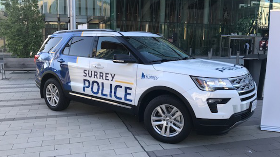 """An SUV marked """"Surrey Police"""" is seen outside the Civic Hotel, where Surrey Mayor Doug McCallum gave his State of the City address Tuesday."""