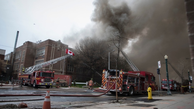 Firefighters work on fire that broke out at York Memorial Collegiate Institute in Toronto on Tuesday, May 7, 2019. THE CANADIAN PRESS/ Tijana Martin