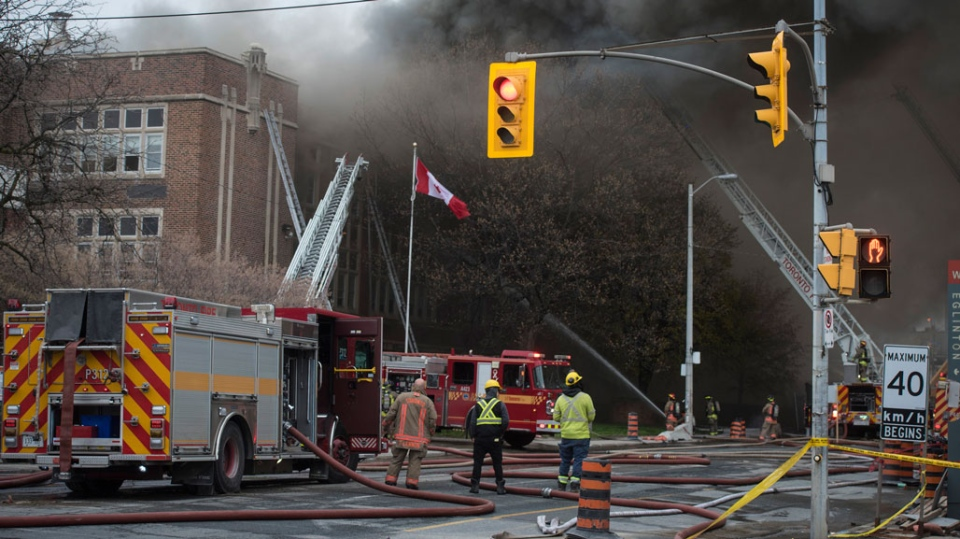 Firefighters work on fire that broke out at York Memorial Collegiate Institute in Toronto on Tuesday, May 7, 2019. (THE CANADIAN PRESS/ Tijana Martin)