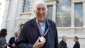 Canadian Jean Vanier founder of L'Arche communities poses for a photograph after he received the Templeton Prize at St Martins-in-the-Fields church in London, Monday, May 18, 2015. L'Arche started in northern France in 1964 now has some 147 communities where people with and without intellectual disabilites live and work together as peers.(AP Photo/Alastair Grant)