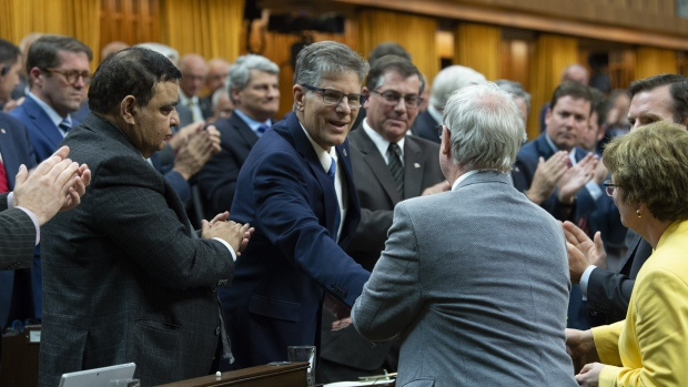 MPs gather around Conservative MP for Langley-Aldergrove Mark Warawa following his final speech in the House of Commons, Tuesday May 7, 2019 in Ottawa. THE CANADIAN PRESS/Adrian Wyld