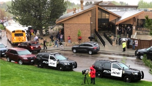 Police and others are seen outside a recreation center where students are reunited with their parents, in the Denver suburb of Highlands Ranch, Colo., after a shooting at STEM School Highlands Ranch Tuesday, May 7, 2019. (AP Photo/David Zalubowski)