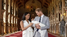 Prince Harry and Meghan with their newborn son