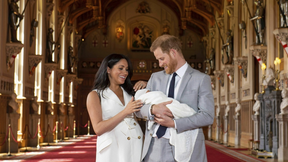 Prince Harry and Meghan, Duchess of Sussex, during a photocall with their newborn son, in St George's Hall at Windsor Castle, Windsor, on May 8, 2019. (Dominic Lipinski/Pool via AP)