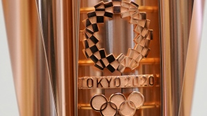 This March 20, 2019, file photo shows the emblem of the Olympic torch of the Tokyo 2020 Olympic Games during a press conference in Tokyo. (AP Photo/Eugene Hoshiko, File)