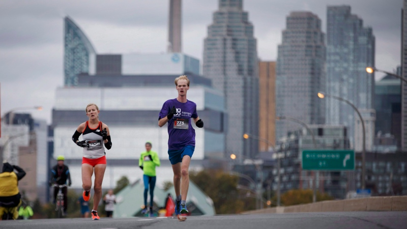 Runners make their way along the route of the Toronto Scotiabank Waterfront Marathon on Sunday, Oct. 21, 2018. (THE CANADIAN PRESS/Cole Burston)