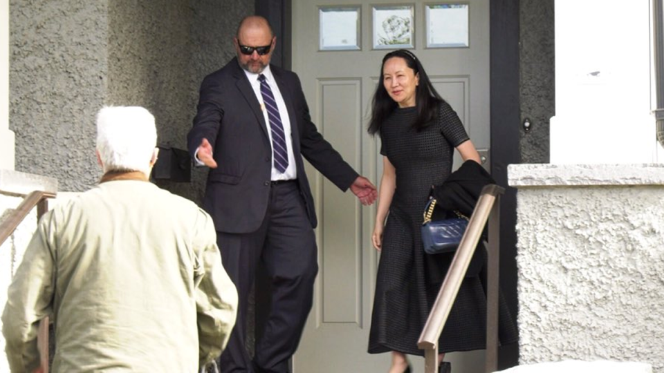 Meng Wanzhou, right, leaves home for a court appearance in downtown Vancouver on Wednesday, May 8, 2019.