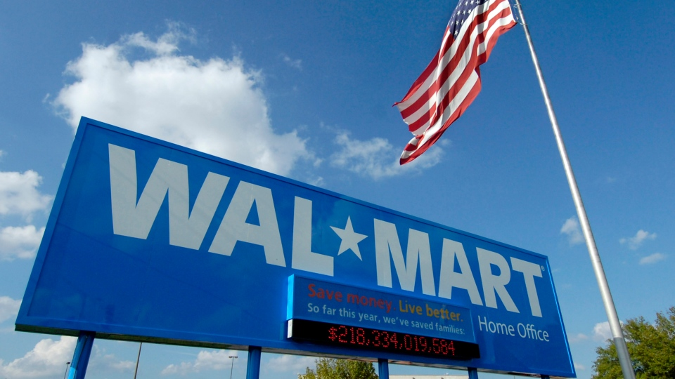 FILE - In this Oct. 5, 2007, file photo, an American flag flies in front of the Walmart Stores Inc. headquarters in Bentonville, Ark. (AP Photo/April L. Brown, File)