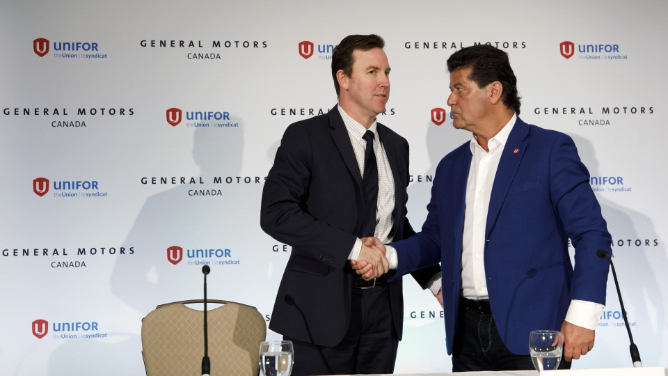 General Motors Canada president Travis Hester, left, and Unifor national president Jerry Dias shake hands during a press conference announcing GM's investment in the Oshawa assembly plant, in Toronto, Wednesday, May 8, 2019. THE CANADIAN PRESS/Cole Burston