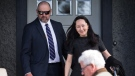 Huawei chief financial officer Meng Wanzhou, back right, is accompanied by a private security detail as she leaves her home to attend a court appearance in Vancouver, on Wednesday May 8, 2019. (THE CANADIAN PRESS/Darryl Dyck)